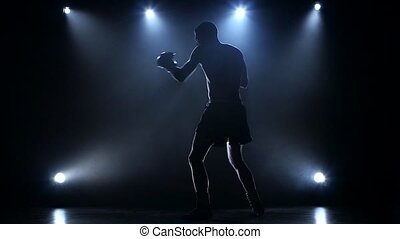 Boxer develops a right and a left hook. Slow motion - Boxer...