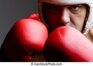 boxer in helmet and boxing gloves close up - boxer in...
