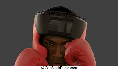 Boxer in helmet punching towards