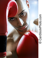 boxer in red gloves fighting
