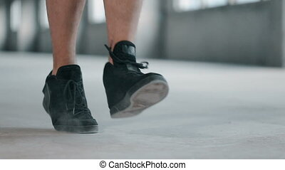 Boxer Jumps Rope Forward - Boxer in black sneakers jumping...