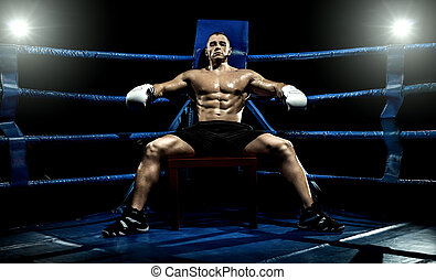boxer on boxing ring, tired time-out