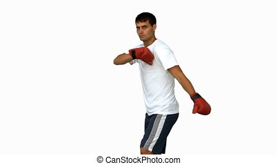 Boxer performing an air kick on white screen in slow motion