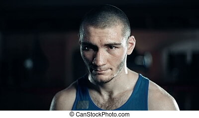 Boxer Portrait - Portrait of boxer wiping sweat from his...