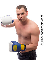 boxer posing with gloves on a white background