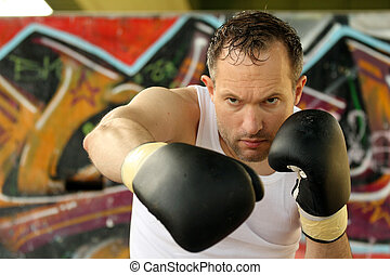 boxer punch - professional boxer doing punching exercises...