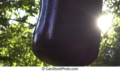 Boxer punching bag, on the outdoor. Slow motion sequence. -...