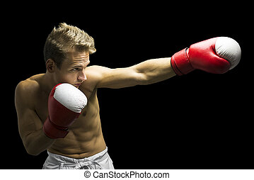 Boxer punching - Young boxer fighter performing a punch. ...