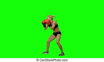 Boxer standing in the front and sends butted an opponent standing on the spot. Green screen. Side view