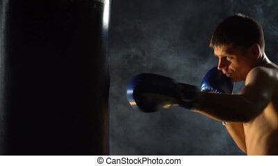 Boxer training in the gym on a dark background