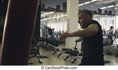 Boxer training punching bag - Slow motion. Boxer training...