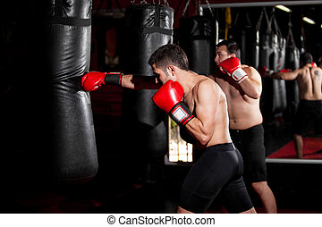 Boxers training with a punching bag