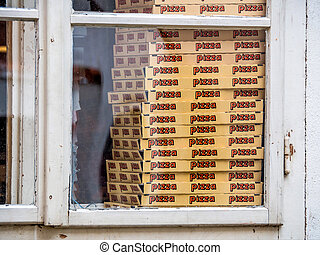 boxes for pizza in a pizzeria. street sales in the - in a...