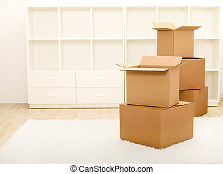 Boxes in front of empty shelves - moving concept - Cardboard...