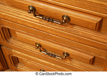 Boxes of a locker. A locker from a tree, with carved incrustation and iron handles
