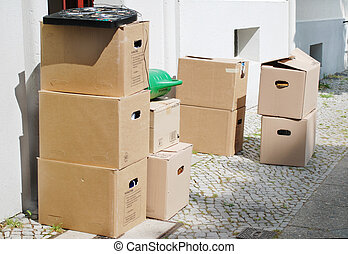 boxes - moving day with many boxes standing in front of a...