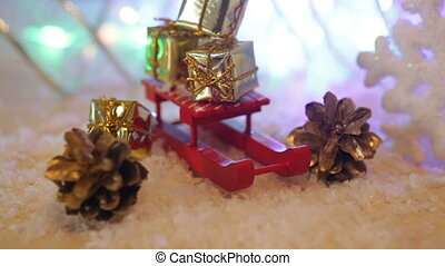 boxes with gifts on the Red toy sled Christmas background