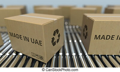 Boxes with MADE IN UAE text on roller conveyor. United Arab Emirates goods related 3D rendering