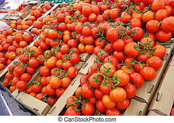 Boxes with tomatoes in the supermarket