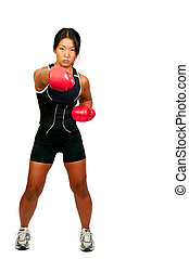 Boxing - A beautiful young woman wearing a pair of boxing...