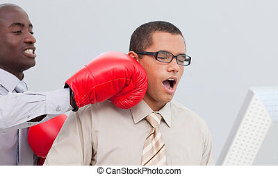 Boxing a businessman in the office