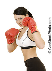 Boxing - Beautiful Caucasian woman working out with boxing...