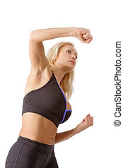 Boxing blondie - Blonde tanned girl in sportive gear boxing