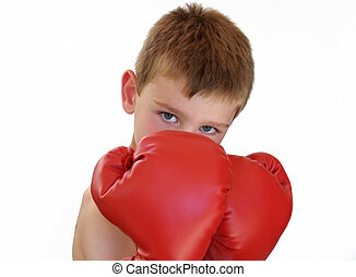 boxing boy - young boy wearing red boxing gloves