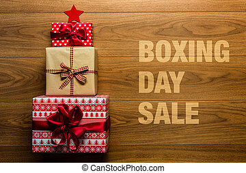 Boxing day Sale concept on wooden background, view from above