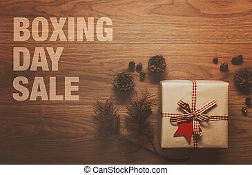 Boxing Day Sale theme background, on wooden table
