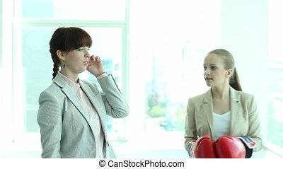 Boxing employer - A businesswoman talking on the phone and...