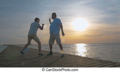 Boxing exercise outdoor at sunset