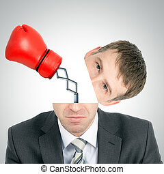 Boxing glove beating from businessmans head