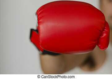 Boxing glove headed into the front of you