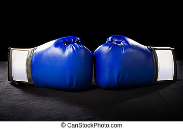 Boxing Gloves - boxing gloves or martial arts gear on a...