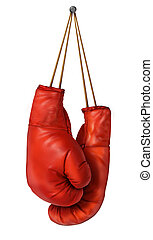 Boxing gloves hanging on a isolated white background with laces nailed to a wall as a business or sport concept of a person that retires gives up the fight or prepares for competition.