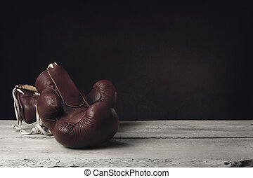 Boxing Gloves lying on wooden Planks
