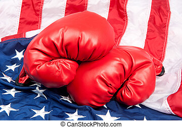 Boxing gloves on American flag