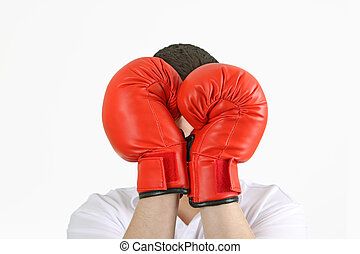 Boxing Gloves - Young man holding red box gloves on white...