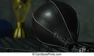 Boxing punch bag on black background. Black punching bag...