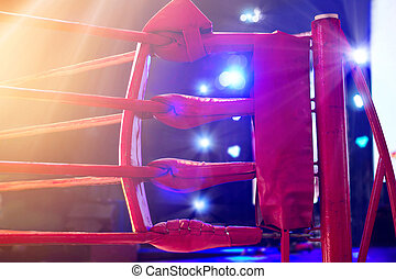 Boxing ring red corner and floodlights, dramatic lighting