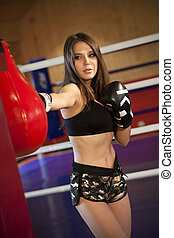 Boxing training in gym