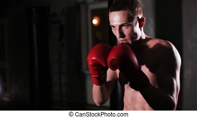 Boxing Training with a Coach - Male Boxer Working the Focus...