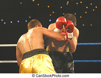 Two boxers go toe to toe in the ring.