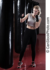 Boxing woman during her training