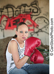 boxing woman with graffiti