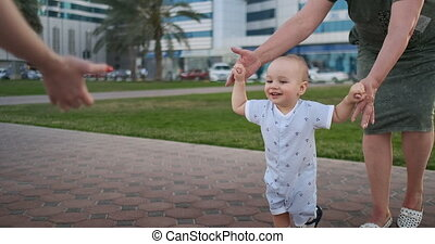 Boy 1 year is learning walks, laughing and smiling with grandma