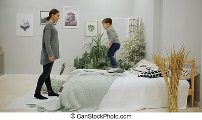 Boy 5-7 years old in blue jeans and a gray sweater European...