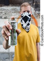 Boy after painting graffiti