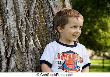 Boy against a tree